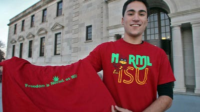 Dec. 2012: Josh Montgomery, 20, a sophomore at Iowa State, wears his NORML chapter's T-shirt while displaying the back of it. ISU had approved the shirt, which includes the university's Cy logo on the front and a marijuana leaf on the back.