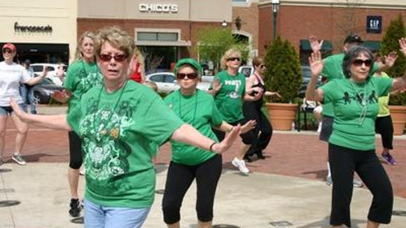 A flash mob celebrates St. Patrick's Day in The Streets of Indian Lake in Hendersonville in 2012. (File Photo)
