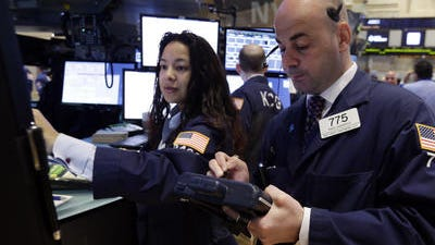 Specialist Wingszi Chiang, left, and trader Fred DeMarco work on the floor of the New York Stock Exchange.U.S. stocks are edging lower after the U.S. reported its economy slowed more drastically in the first quarter than economists expected. The Dow Jones industrial average was down one point to 16,534 shortly after the market opened Wednesday. The Standard & Poorâ??s 500 index fell three points, or 0.1 percent, to 1,874. The Nasdaq was off 20 points, or 0.5 percent, to 4,082.