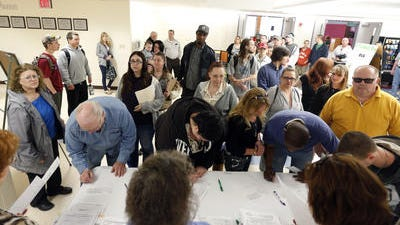 Job seekers line up for a job fair in Hudson, N.Y. The Labor Department says weekly applications for unemployment aid dropped 19,000 to a seasonally adjusted 284,000. That's the lowest reading since February 2006, nearly two years before the Great Recession began.