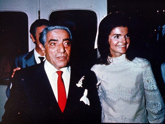 Aristotle Onassis stands with his new wife, Jacqueline