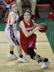 Signe Fronek, right, drives to the basket against Black