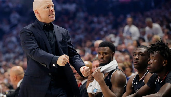 Cincinnati Bearcats head coach Mick Cronin paces his sideline frustrated in the first half of the 85th Annual Crosstown Shootout game between the Xavier Musketeers and the Cincinnati Bearcats at the Cintas Center in Cincinnati on Saturday, Dec. 2, 2017. At halftime the Musketeers led 43-30.