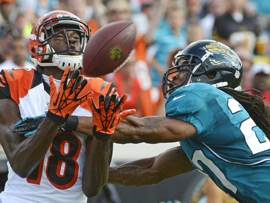 Bengals wide receiver A.J. Green catches a pass for a 42-yard gain in front of Jacksonville Jaguars cornerback Rashean Mathis in 2012.