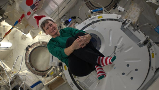 Astronaut Peggy Whitson celebrating Christmas aboard the International Space Station in 2015. Learn how astronauts celebrate the holidays during Holidays in Space: Rockin' with Santa on Saturday.