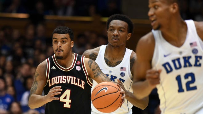 Feb 21, 2018; Durham, NC, USA;Louisville Cardinals guard Quentin Snider (4) dribbles up court during the first half against the Duke Blue Devils at Cameron Indoor Stadium. Mandatory Credit: Rob Kinnan-USA TODAY Sports
