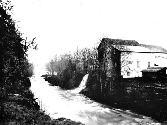 The Scotts Mills grist mill is seen on Butte Creek in 1894.