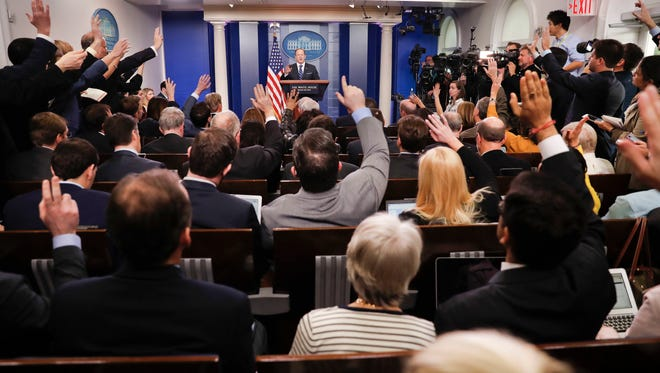 In this Feb. 22 photo, reporters raise their hands as White House Press Secretary Sean Spicer takes questions during a daily briefing in the Brady Press Briefing Room of the White House in Washington. In 2017, journalism marks its annual Sunshine Week at an extraordinary moment in the relationship between the presidency and the press.