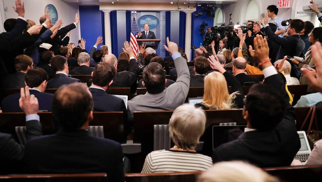 In this Wednesday, Feb. 22, 2017 photo, reporters raise their hands as White House Press Secretary Sean Spicer takes questions during a daily briefing in the Brady Press Briefing Room of the White House in Washington. In 2017, journalism marks its annual Sunshine Week at an extraordinary moment in the relationship between the presidency and the press. (AP Photo/Pablo Martinez Monsivais)