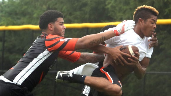 Spring Valley's Devan Lawson, left, defends against Zion Powell of Mamaroneck during the Big Apple 7 on 7 at Harrison High School June 11, 2016. Schools from all over the area sent teams of seven players to participate in a day of passing scrimmages.