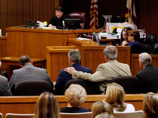 Mike Hubbard sits in the middle while attorney David