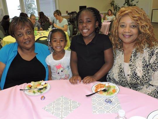 Enjoying the event, from left are grand-aunt Sandra Newman, Sarai Dowdy, Sanai Dowdy and grandmother Sylvia Albani.