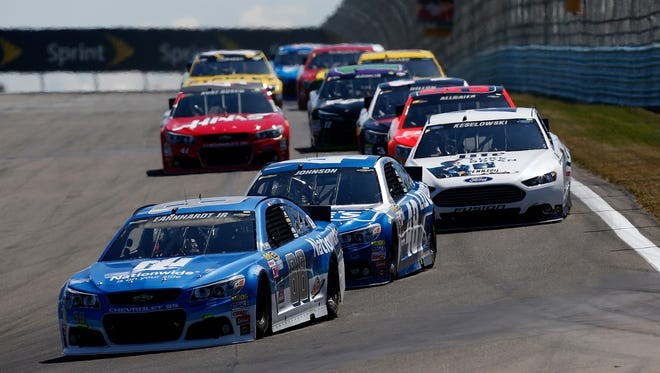Dale Earnhardt Jr. leads a pack of cars during the NASCAR Sprint Cup Series Cheez-It 355 at The Glen at Watkins Glen International on Aug. 9.