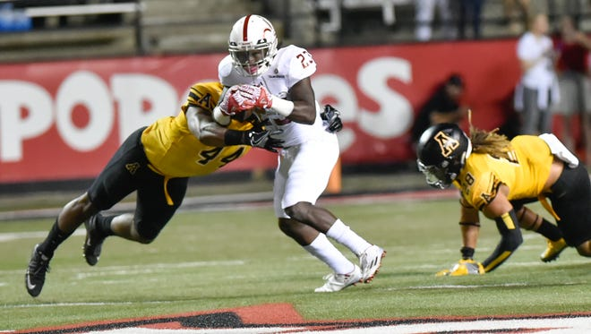 UL running back Darius Hoggins breaks a tackle for extra yards during the Ragin' Cajuns' 24-0 loss to Appalachian State last season.