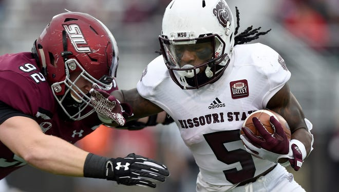 Missouri State wide receiver Deion Holliman (5) looks to get past SIU defensive end Jordan Berner (92) in the first quarter at Saluki Stadium on Saturday.