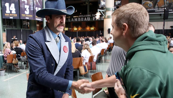 Aug 29, 2018; Green Bay, WI, USA; Green Bay Packers quarterback Aaron Rodgers (12) greet people at his table during the Green Bay Chamber of Commerce Welcome Back Packers Luncheon at Lambeau Field. Jim Matthews/USA TODAY NETWORK-Wisconsin via USA TODAY NETWORK