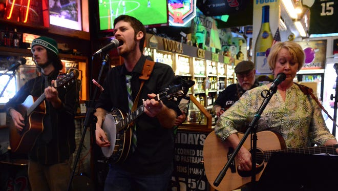 The Sons of Wexford Irish folk band perform at the Miracle Pub in Toms River.