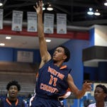 Wayne County's Ra Darrius McFarland (11) shoots a running one hander from the wing on Thursday, March 5, 2015, in the MHSAA state basketball tournament at the Lee E. Williams Athletics & Assembly Center on the Jackson State University campus in Jackson, Miss.