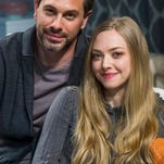 "In this image released by Polk PR, Thomas Sadoski, left, and Amanda Seyfried appear during a performance of Neil LaBute's new play, ""The Way We Get By"", in New York."