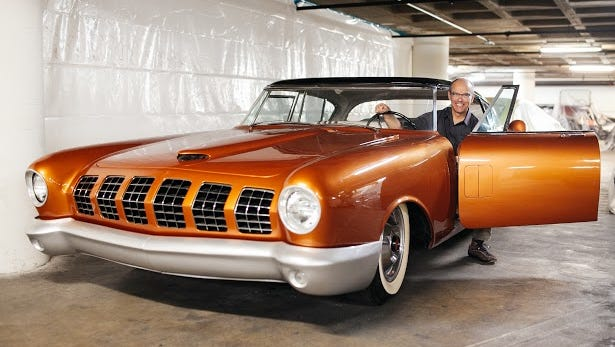 Leslie Kendall, curator of the Petersen Automotive Museum in Los Angeles, shows off a concept car that's part of the collection, the Mercury D528.