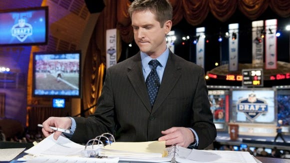 ESPN college football and NFL Draft Analyst Todd McShay reviews his notes during a recent draft.