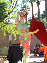 """The reception included """"live painted sculptures"""" scattered"""