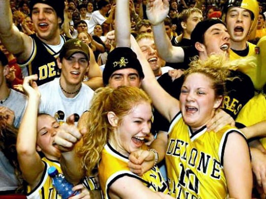 Delone's Steph Vial, left, Rachel Gates, and Krystal Holzer celebrate with fans after the Squirrettes won their first state title in 2003.