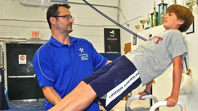 Coach Jason Hebert works with John Jay Middle School student Henry Weigel, 12, of Katonah.