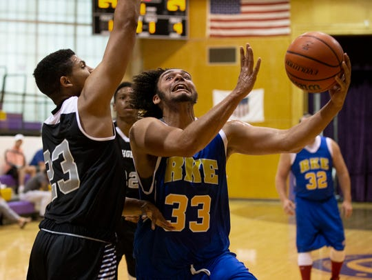RKE's Dan O'Neill drives to the basket during first
