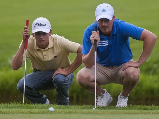 Drake Hull (left) and Bryan Smith line up their putts on the second day of the Vermont Amateur golf tournament at the Burlington Country Club on Friday, July 9, 2014.