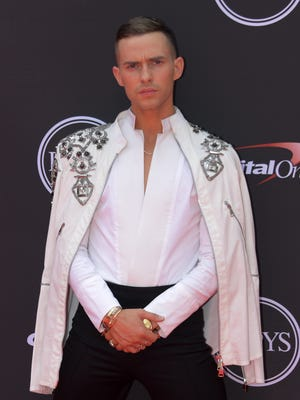 Olympic figure skater Adam Rippon arrives for the 2018 ESPYs at Microsoft Theatre in Los Angeles.