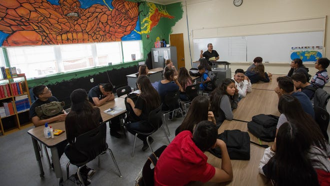Alberto Prieto, center, a social studies teacher at La Academia Dolores Huerta starts to take roll, Thursday August 16, 2018. La Academia Dolores Huerta, is now settling into its new home in Mesilla Park.
