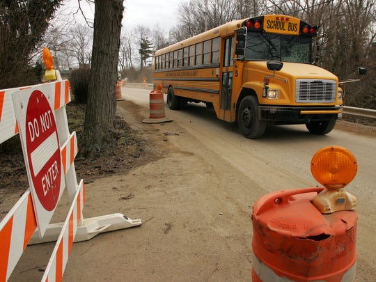 A school bus travels down Liebs Island Road Tuesday which has been reduced to one lane due to dam construction traffic.