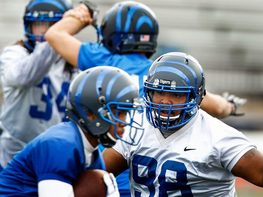 December 27, 2015 - Memphis defensive lineman Jared Gentry (middle) looks for the running back during practice at Birmingham-Southern College as the Tigers prepare for their bowl game against Auburn in Birmingham, Ala. Gentry and offensive lineman Drew Kyser, both freshman, were high school teammates in Opelika, Al., and will play in their home state in their first bowl game Wednesday.  (Mark Weber/The Commercial Appeal)