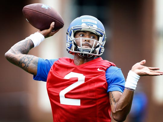 University of Memphis backup quarterback David Moore runs through drills during the first day of practice on July 28, 2017.