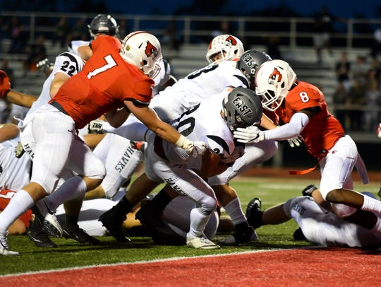 East running back Jack Dobroszsi (30) runs the ball