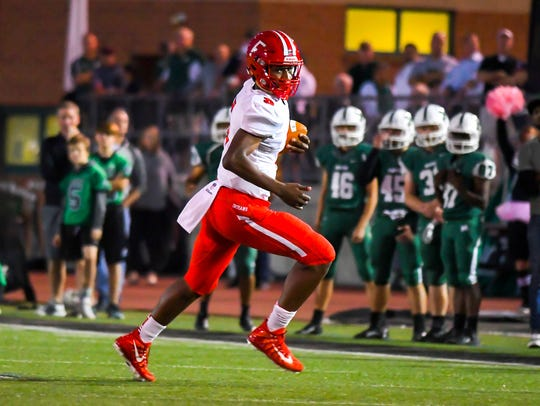 Fairfield quarterback Jeff Tyus runs the ball against