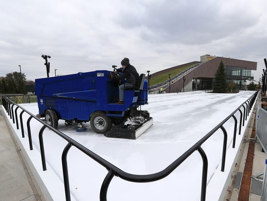 A Zamboni resurfaces the ice rink Tuesday in the Green Bay Packers' Titletown District in Ashwaubenon.
