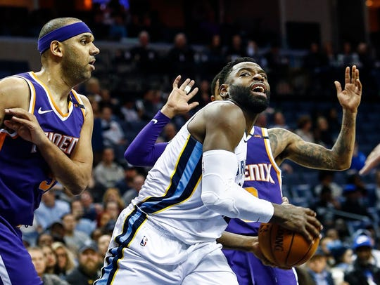 Memphis Grizzlies guard Tyreke Evans (right) drives