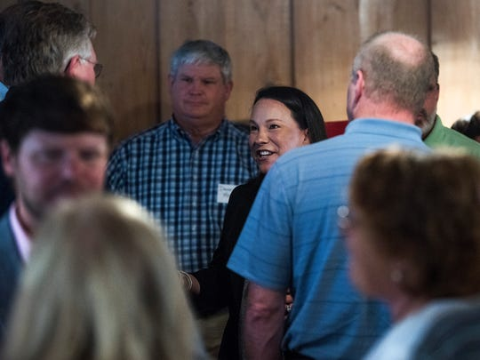 U.S. Representative Martha Roby meets with locals during a fish fry in Andalusia, Ala., on Wednesday May 30, 2018, while campaigning for re-election in south Alabama.