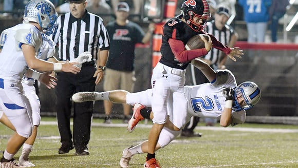 Pisgah quarterback Tanner Wike pushes past Polk County's