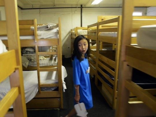 Grace Saal, 9, walks through the COTS waystation during