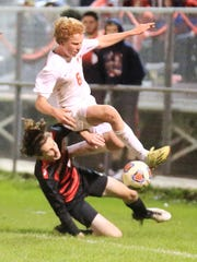 Trying to elude a Grand Blanc player in pursuit of