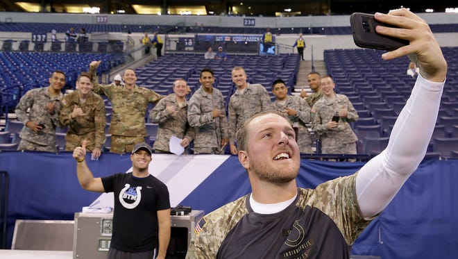 Indianapolis Colts punter Pat McAfee (1) takes a selfie with members of the US Armed series. The Indianapolis Colts host the Tennessee Titans in their NFL football game Sunday, November 20, 206, afternoon at Lucas Oil Stadium