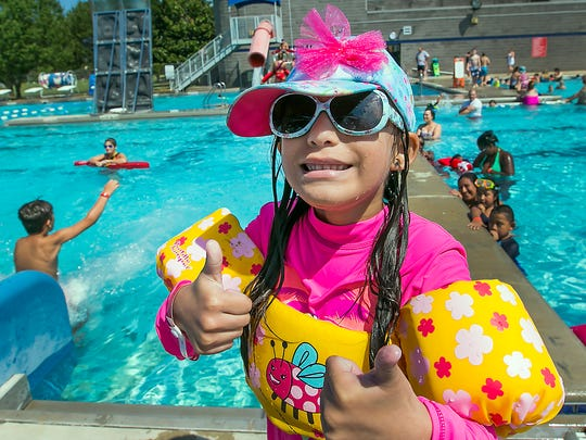 Evelyn Zernuno gives her visit to Boro Beach a thumbs up during the Labor Day Beach Party on Sept. 5, 2016, at the outdoor pool at SportsCom.
