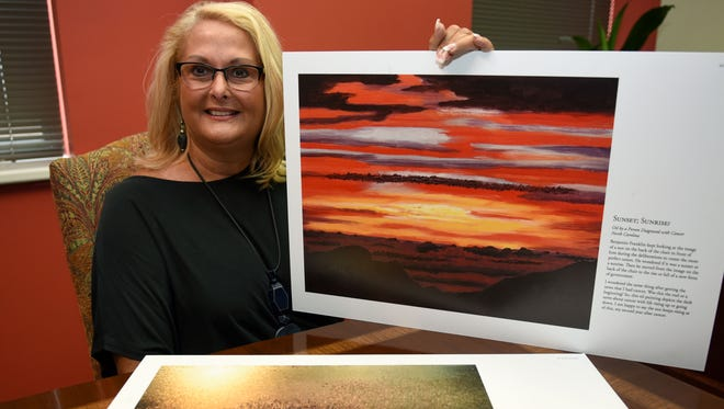 Gaye Fortner, CEO of HealthCare 21 Coalition, with some of the artwork for their Upcoming Cancer Art day at KMA.