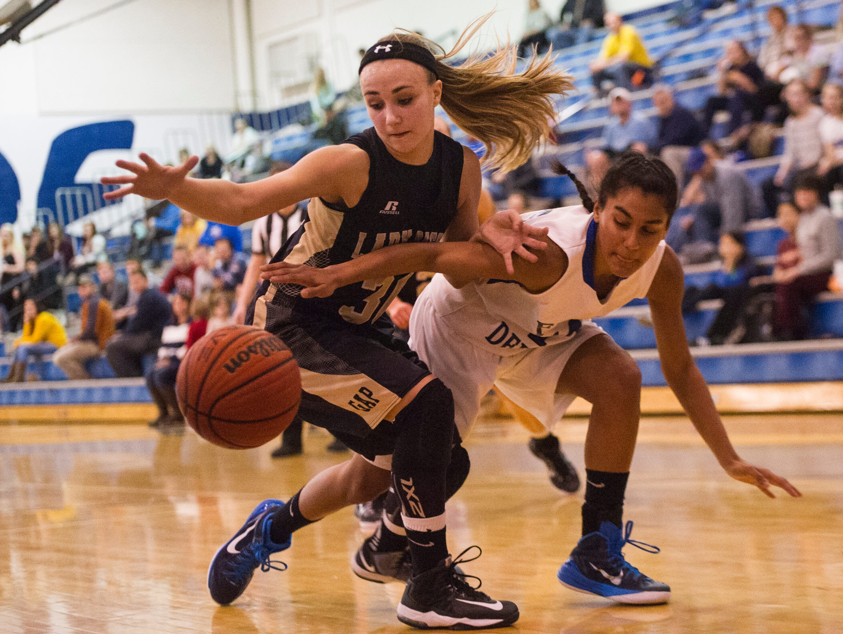 Buffalo Gap's Destiny Harper, left, and Fort Defiance's Tiffany Taylor fight for control of the during their game Friday.
