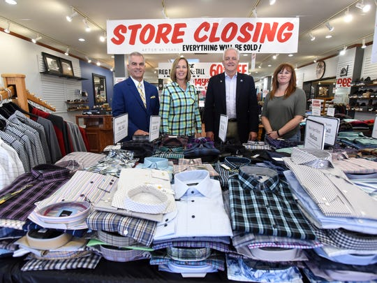 Doug Pickrell, Star Pickrell, Bruce Barclay and Shellie Benson, from left, stand in the showroom of Wade's Clothing in Zanesville. The store is closing after more than 40 years in business.
