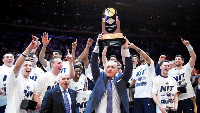 Penn State Nittany Lions head coach Patrick Chambers celebrates with his team after defeating the Utah Utes to win the NIT championship.