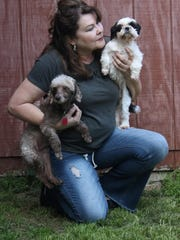 Gabriele Kappers, founder of Dixieland Dog Rescue, holds two rescues — a poodle who will be up for adoption soon and a Shih Tzu she owns herself.